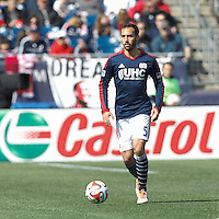 New England Revolution defender A.J. Soares (5) brings the ball forward.  In a Major League Soccer (MLS) match, the New England Revolution (blue/white) tied Vancouver Whitecaps FC (white), 0-0, at Gillette Stadium on March 22, 2014.