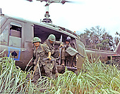 "Quang Tri, Vietnam - October 13, 1968 -- Members of Company ""A"", Second Batallion, 8th Calvary, First Calvary Division, jump from an UH-1D helicopter in the mountainous area located approximately 10 km from Quang Tri, Vietnam on October 13, 1968 to search for a bunker complex..Credit: Ronald Delaurier - U.S. Army via CNP"