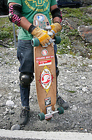 Rider with decorated board. The first ever Norwegian Longboarding Championship was held during the Extreme Sport Week, an annual event that draws adrenalin junkies to the small Norwegian mountain town of Voss. © Fredrik Naumann