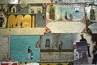 Retablos thanking Saint Francis of Assisi for miracles in the Templo de la Purisima Concepcion, the parish church or parroquia in the 19th-century mining town of Real de Catorce, Mexico. Real de Catorce became a virtual ghost town during the early part of the 20th century. It has recently become a popuar destination for travellers. It is also a Catholic pilgrimage site.