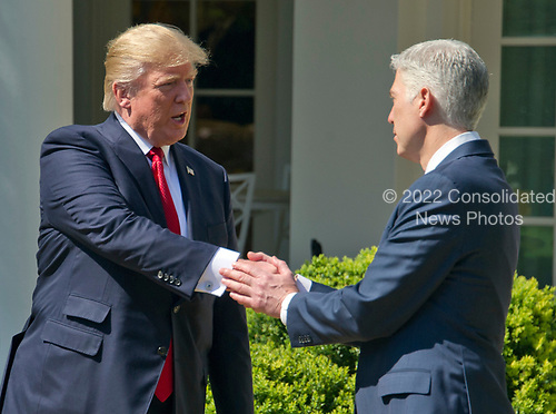 United States President Donald J. Trump, left, shakes hands with Associate Justice of the US Supreme Court Neil Gorsuch during the Oath of Office ceremony in the Rose Garden of the White House in Washington, DC on Monday, April 10, 2017.<br /> Credit: Ron Sachs / CNP<br /> (RESTRICTION: NO New York or New Jersey Newspapers or newspapers within a 75 mile radius of New York City)