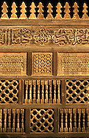 An ornately Carved wooden wall partitions of a section of a mosque, old Islamic Cairo, Egypt.