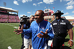 UK head coach Joker Phillips greets friends on the field before UK's 23-16 win over U of L, kicking off  Phillip's reign as head coach on Saturday, September 5, 2010. Photo by Britney McIntosh | Staff
