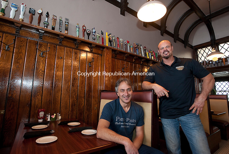 WATERBURY, CT-031514JS03- The owners of Pies &amp; Pints in Middlebury Theo Anastasiadis, left, and business partner Christos Gogas, right,  have opened a new location at the former Drescher's Restaurant on Leavenworth Street in Waterbury. The new location is called Pies and Pints Restaurant and Brewery. <br /> Jim Shannon Republican-American