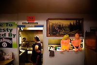 Cooks work in the kitchen at the Testicle Festival at the Rock Creek Lodge in Clinton, MT.  The Rock Creek Lodge in Clinton, MT, has hosted the annual Testicle Festival since the early 1980s.  The four day festival and party revolves around the consumption of so-called Rocky Mountain Oysters, which are deep-fried bull testicles.