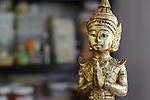 Thai statue in the garden kitchen of Thai chef, Tukata Bird, Ryhall, Rutland, near Stamford, Lincolnshire