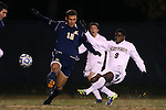 24 November 2013: Wake Forest's Sean Okoli (9) shoots past Navy's Derek Vogel (12). The Wake Forest University Demon Deacons played the Naval Academy Midshipmen at Spry Stadium in Winston-Salem, NC in a 2013 NCAA Division I Men's Soccer Tournament Second Round match. Wake Forest won the game 2-1.