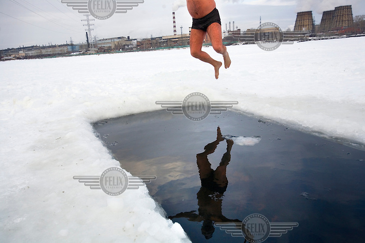 An ice-swimmer jumps into a frozen lake in Yekaterinburg, capital of Russia's central Ural region on the edge of Siberia. The temperature was around -10 degrees celcius.