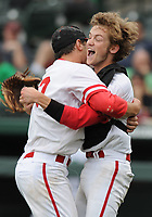NWA Democrat-Gazette/ANDY SHUPE<br /> Harding Academy starter Peydon Harlow (left) and catcher Griffin Metheny celebrate Friday, May 19, 2017, after the Wildcats' 4-0 win over Greenland during the Class 3A state championship game at Baum Stadium in Fayetteville. Visit nwadg.com/photos to see more photographs from the game.