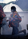 A K'iche' Maya indigenous woman participates in Maya religious rites in Chichicastenango, Guatemala.