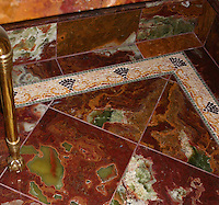 """3 5/8"""" Nautilus stone mosaic border in polished Bardiglio, Red Lake, Rosa Salmon, Persion Gold, and Red Travertine."""