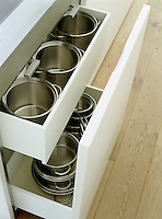 Deep open drawers designed for storing a range of pots and pans