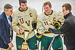 29 December 2013:  University of Vermont Catamount Defenseman Michael Paliotta (left), a Junior from Westport, CT, and Forward H.T. Lenz, a Senior from Vienna, VA, the team co-captains, accept the tournament awards after the final game against the Canisius College Golden Griffins at Gutterson Fieldhouse in Burlington, Vermont. The Catamounts defeated the Golden Griffins 6-2 to capture the 2013 Sheraton/TD Bank Catamount Cup NCAA Hockey Tournament for the second straight year. Mandatory Credit: Ed Wolfstein Photo *** RAW (NEF) Image File Available ***