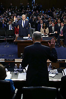 United States Senate Judiciary Committee Chairman Charles Grassley (Republican of Iowa), back to the camera, swears in Judge Neil Gorsuch during the first day of his Supreme Court confirmation hearing before the Senate Judiciary Committee in the Hart Senate Office Building on Capitol Hill March 20, 2017 in Washington, DC. Gorsuch was nominated by President Donald Trump to fill the vacancy left on the court by the February 2016 death of Associate Justice Antonin Scalia. <br /> Credit: Alex Wong / Pool via CNP /MediaPunch
