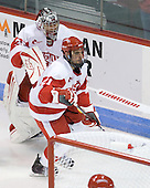 Adam Kraus (BU - 32), Sean Escobedo (BU - 21) - The Boston University Terriers defeated the visiting University of Toronto Varsity Blues 9-3 on Saturday, October 2, 2010, at Agganis Arena in Boston, MA.