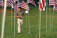 David West walks among 2,996 flags placed at Kennesaw Mountain National Battlefield Park by the Kiwanis Club of Marietta in remembrance of people who died in the terrorist attacks of five years ago.<br />