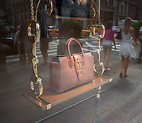 Handbags are featured in the window of the Gucci store on Fifth Avenue in New York on Wednesday, July 31, 2013. Brands such as Gucci, Michael Kors, Tory Burch and Kate Spade are cutting into Coach's sales of leather goods in the luxury market. (© Richard B. Levine)