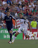 Philadelphia Union midfielder Kyle Nakazawa (13) controls the ball as New England Revolution midfielder Chris Tierney (8) defends. In a Major League Soccer (MLS) match, the Philadelphia Union defeated the New England Revolution, 3-0, at Gillette Stadium on July 17, 2011.
