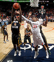 CHARLOTTESVILLE, VA- DECEMBER 6:  Bryon Allen #0 of the George Mason Patriots grabs a rebound next to Akil Mitchell #25 of the Virginia Cavaliers during the game on December 6, 2011at the John Paul Jones Arena in Charlottesville, Virginia. Virginia defeated George Mason 68-48. (Photo by Andrew Shurtleff/Getty Images) *** Local Caption *** Akil Mitchell;Byron Allen