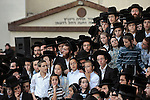 Ultra-Orthodox Jewish men take part in a burial ceremony in Bnei Brak, central Israel, for Torah scrolls that were destroyed in a fire. Eleven torah scrolls were burnt in a fire that broke out in a synagogue during the Jewish holiday of Sukkot, following a short circuit in the Holy Ark.