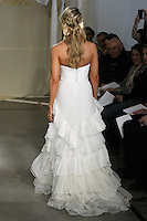 Model walks runway in a Bayberry wedding dress by Carol Hannah Whitfield, for the Carol Hannah Spring Summer 2012 Bridal collection runway show.