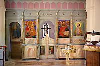 Interior of a chapel and Orthodox icons of the Byzantine of Nea Moni built by Constantine IX and Empress Zoe after the miraculous appearance of an Icon of the Virgin Mary at the site and inaugurated in 1049. Scene of a terrible sack and massacre of hundreds of Chiots and priests during the Ottoman sack of Chios in reprisal for the 1821 Greek War of Indipendance. Nea Moni monastery, Chios Island, Greece. A UNESCO World Heritage Site.