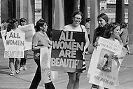 "06 Dec 1969, Atlantic City, New Jersey, USA --- Women's Liberation Movement demonstrators carrying picket signs which state ""All Women are Beautiful"" in protest against the Miss America pageant in Atlantic City, New Jersey. --- Image by © JP Laffont/Sygma/CORBIS"