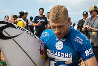 Pipeline, North Shore of Oahu, Hawaii Friday December 19 2014) Defending World Champion Mick Fanning (AUS) after being eliminate from the 2014 World Title race.- The final stop of the 2014  World Championship Tour, the Billabong Pipe Masters in Memory of Andy Irons, was  ccompleted today in NW double overhead surf. <br /> Gabriel Medina (BRA) became the first ever Brazilian World Champion after both rival contenders , Kelly Slater (USA) and Mick Fanning (AUS) were eliminated from the contest. Medina went onto finish 2nd overall behind Julian Wilson (AUS). <br /> In the overlapping heat format Wilson surf three consequent heats and still had enough entry to take out the 30 minute final.<br /> By winning the final Wilson also won the covered Vans Triple Crown of Surfing for best overall performance through the whole Triple Crown.<br /> <br /> The Billabong Pipe Masters in Memory of Andy Irons will determine this year&rsquo;s world surfing champion as well as those who qualify for the elite tour in 2015. As the third and final stop on the Vans Triple Crown of Surfing Series  the event will also determine the winner of the revered three-event leg.<br /> <br />  Photo: joliphotos.com