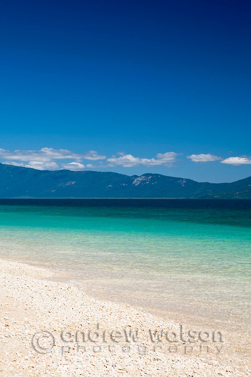 Coral sand and clear waters of Nudey Beach.  Fitzroy Island National Park, Cairns, Queensland, Austtralia
