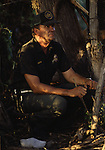 A U.S. Border Patrol Agent in Del Rio, Texas, waits for suspected illegal aliens to cross a field. While the traditional mission of the United States Border Patrol has always been the detection and prevention of the illegal entry of aliens and smuggling of illegal contraband into the United States anywhere other than a designated port-of-entry, the dawn of the age of terrorism within our nation has added a new and high priority mission: to detect and prevent the entry of terrorists and their weapons into the United States. Jim Bryant Photo..&copy;2006. All Rights Reserved.
