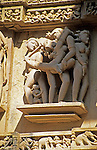 Asia, India, Khajuraho. Detail of temple carving depicting earthly desires at Khajuraho.