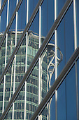 City Point reflected in the glass fa&ccedil;ade of Moor House.<br />