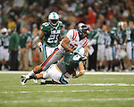 Ole Miss wide receiver Lionel Breaux (21) tackles Tulane receiver Casey Robottom (19) in punt coverage at the Louisiana Superdome in New Orleans, La. on Saturday, September 11, 2010. The play was called back because of penalty. Ole Miss won 27-13.