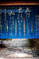 A blue noren curtain hangs at a Kyoto gateway.