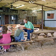 Cowboy Church. Texas, USA. 2007. Children attending the Kiddie Coral, a Sunday School held for the children of the families who attend the Cowboy Church. The building that the Kiddie Coral is held in was actually the Cowboy Church for a number of years, until the barn was built. The new barn houses the rodeo arena, chuck wagon, stage/altar.