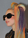 "May 8, 2012, Narita, Japan - Lady Gaga, sporting a leather coat and her rainbow-colored hair, arrives at Narita Airport, east of Tokyo, on Tuesday, May 8, 2012. ..The American pop singer and song writer was in Japan on a ""Lady Gaga/The Born This Way Ball"" world tour. It was her sixth visit to Japan where a teacup and saucer, marked with her lipstick and bearing the Japanese message We pray for Japan along with the stars autograph, has fetched more than $75,000 at auction.(Photo by Natsuki Sakai/AFLO) AYF -mis-."