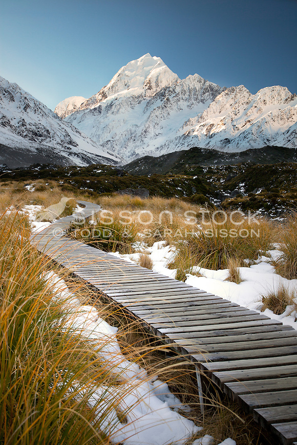 Boardwalk along the Hooker Valley track leading to Hooker Lake. Mt Cook / Aoraki in the background. Winter.