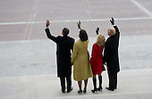 Washington, DC - January 20, 2009 -- United States President Barack Obama waves alongside his wife, Michelle, and US Vice President Joe Biden and his wife, Jill, as former US President George W. Bush and his wife, Laura, leave the US Capitol on the presidential helicopter after Obama was sworn in as the 44th US president in Washington, DC, on January 20, 2009. .Credit: Saul Loeb - Pool via CNP