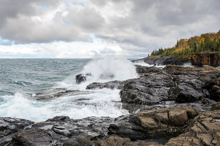 The splash and spray of waves on Lake Superior on a stormy day. Marquette, MI