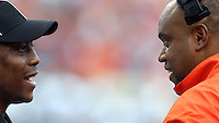 Virginia Cavaliers head coach Mike London talks with a refree during the game at Scott Stadium. Virginia was defeated 30-24. (Photo/Andrew Shurtleff)