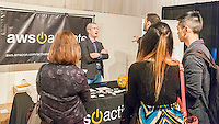 Visitors speak with a representative of Amazon Web Services at the Techweek expo in New York event on Thursday, October 15, 2015. Thousands of visionaries and entrepreneurs attended to network with established and start-up technology companies. (© Richard B. Levine)