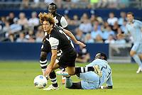 Fabrico Coloccini (2) Newcastle United defender shrugs off the tackle from Kei Kamara Sporting KC.