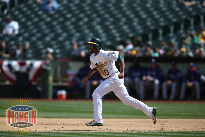 OAKLAND, CA - APRIL 9:  Marcus Semien #10 of the Oakland Athletics runs the bases against the Texas Rangers during the game at O.co Coliseum on Thursday, April 9, 2015 in Oakland, California. Photo by Brad Mangin