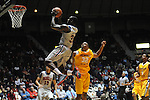 "Ole Miss' Murphy Holloway (31) drives vs. McNeese State's Desharick Guidry (32) at the C.M. ""Tad"" Smith Coliseum in Oxford, Miss. on Tuesday, November 20, 2012. .."