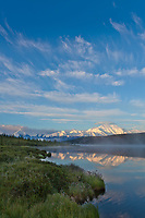Early morning sunrise on the face of Mt McKinley, locally called Denali, and Wonder Lake, at the west end of Denali National Park, interior, Alaska.