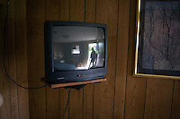 A portrait of Motel Caswell owner Russell Caswell in a room at the motel in Tewksbury, Massachusetts, USA, on Tuesday, Oct. 11, 2011. Caswell's father built the motel in the 1950s. Now, conservative activitists are trying to use federal asset-forfeiture laws to seize the motel, saying that the motel is used by drug dealers to conduct business.  The legal challenge intends to show evidence tying the property to crimes in order to seize the motel....CREDIT: M. Scott Brauer for the Wall Street Journal.slug: FORFEIT
