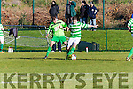 Graham Tarrant Listowel Celtic holds off Stephen Hayes Killarney Celtic during the Munster Junior clash in Celtic Park on Sunday
