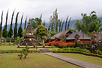 Beautifully manicured gardens, walks, and shrines greet the public outside the inner precincts of the Hindu temple of Ulun Danu at Candikuning, on Bali, Indonesia.  Located in the high hills of the Bedugul, about 30 miles north of Bali's capital city of Denpasar, the temple is built on the shores of the crater Lake Bratan (formed from the sunken crater of a long-dormant volcano).  Much of the inner precincts of the temple is closed to the (non-Hindu) public, but the gardens are spectacular and feature fabulous shrines, statuary, and views.