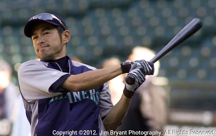 Seattle Mariners right fielder Ichiro Suzuki, of Japan, warms up before the Mariner's s opening home game of the season with the Oakland Athletics at SAFECO Field in Seattle April 13, 2012.  © 2012. Jim Bryant Photo. All Rights Reserved.