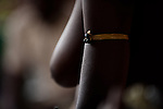 A protective amulet is worn by a Dipo-Yo (an adolescent girl undergoing Dipo).